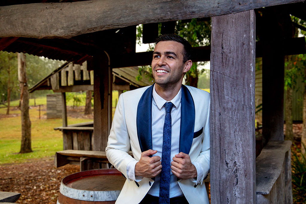 Groom at The Rocks Yandina sunshine coast by Malenyweddingphotography